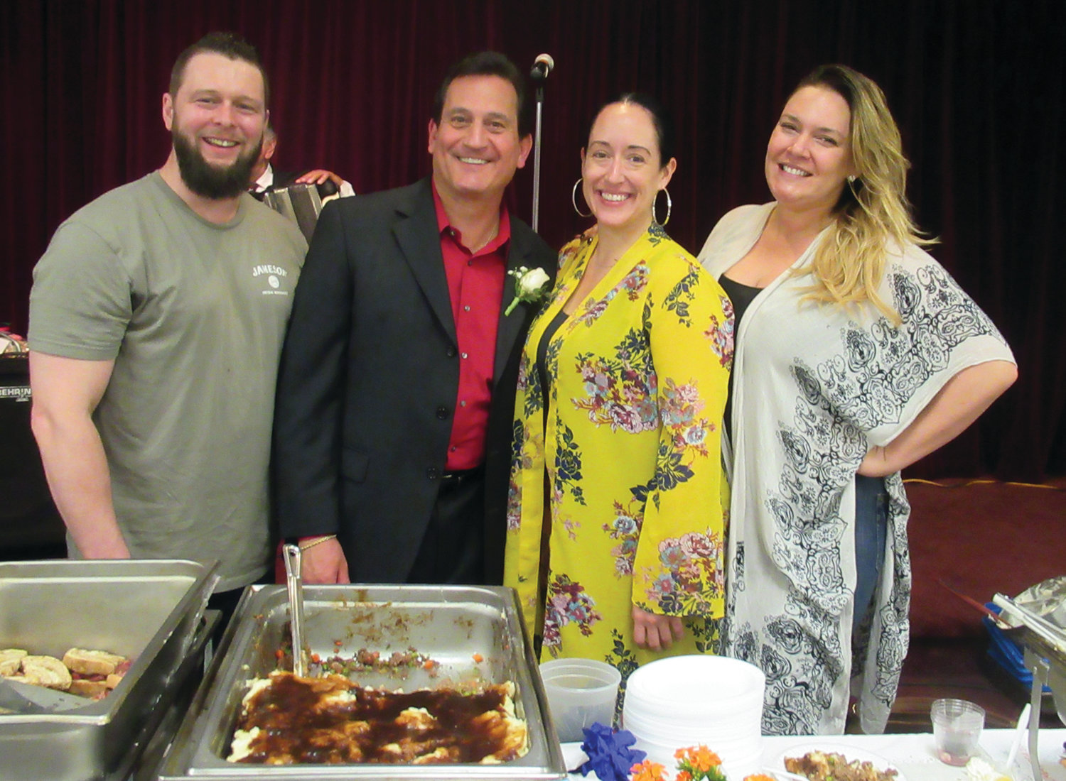 GINA'S GANG: Gina Musto (right), who owns and operates Cucina Rustica in Cranston, is joined by news anchor Mike Montecalvo, Brett Malenfant and Kelly Jackson during Sunday's Primavera in Johnston.