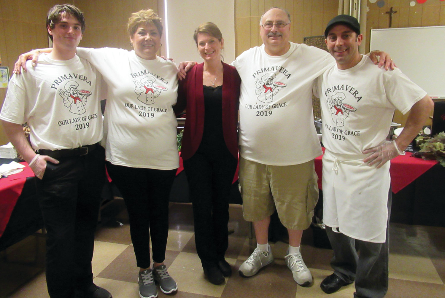 PARMA PALS: Hayden Beaulieu (left), Laura Ashworth (center) and David Ashworth (right) of Parma Restaurant enjoy a lighter moment with Joan Andreozzi and her husband Joe Andreozzi, who chaired what people called the best Primavera ever at Our Lady of Grace Church.