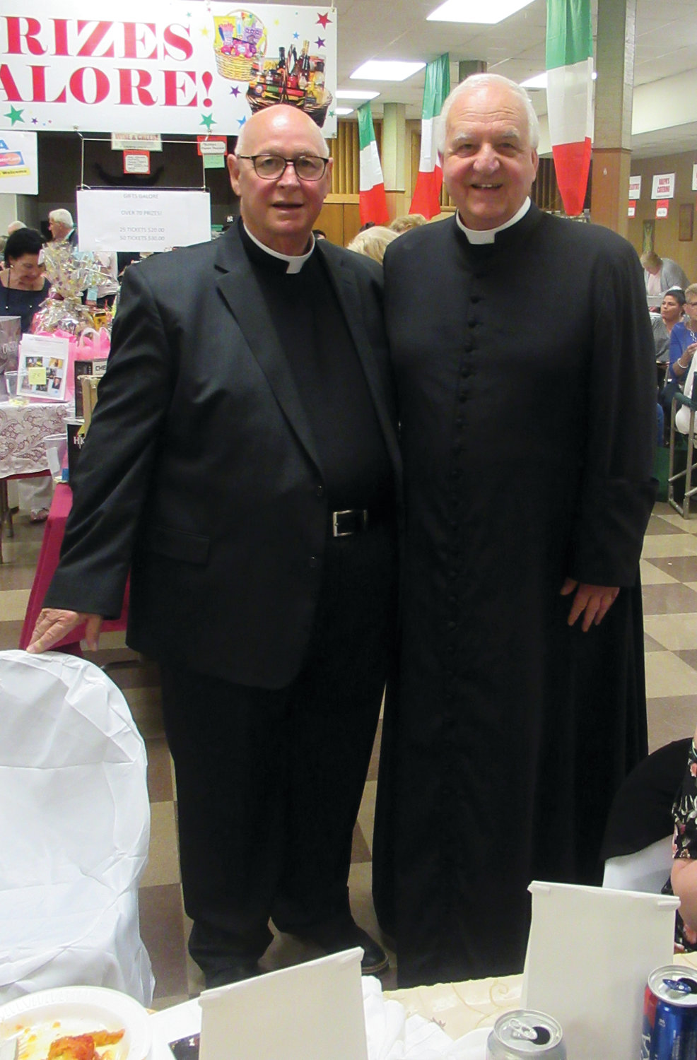 POPULAR PRIESTS: The Rev. Peter J. Gower, the pastor at Our Lady of Grace Church, welcomes Monsignor Carlo F. Montecalvo as grand marshal of the parish's 10th Annual Primavera.