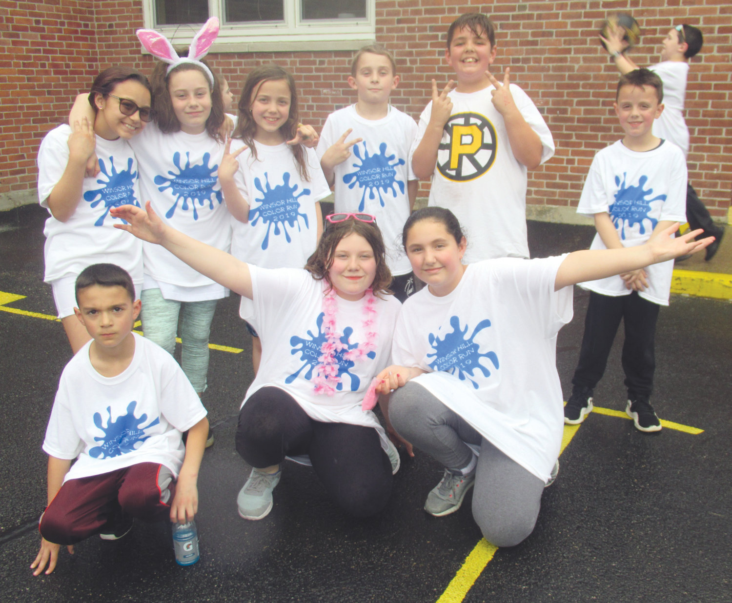 BRIGHT SPIRIT: Students like the children above were decked out in special T-shirts and enjoyed several hours of fun and games during the Johnston elementary school's third annual Color Run.