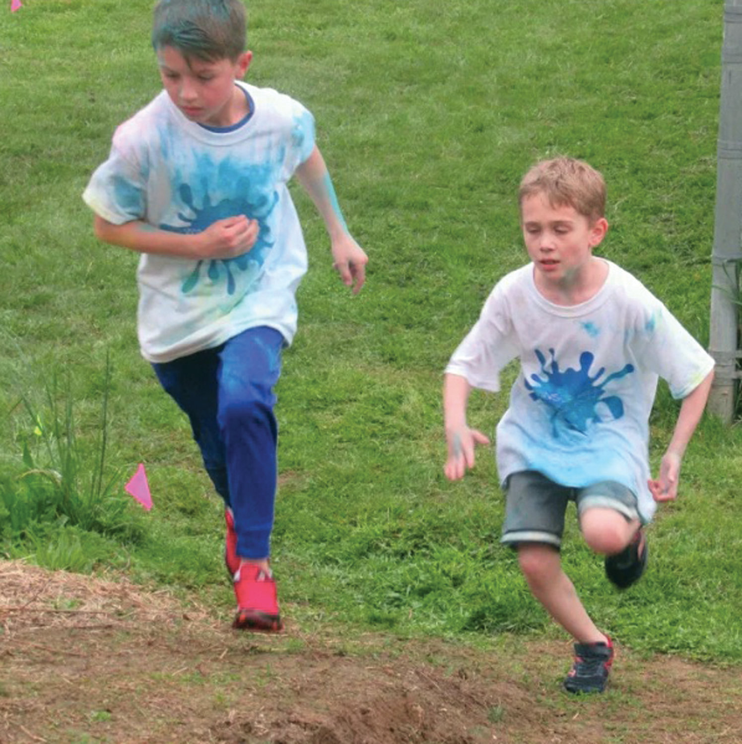 DASHING DUO: There was a race to the finish that included students getting covered in colored cornstarch during Friday's third annual Color Run at Winsor Hill School.