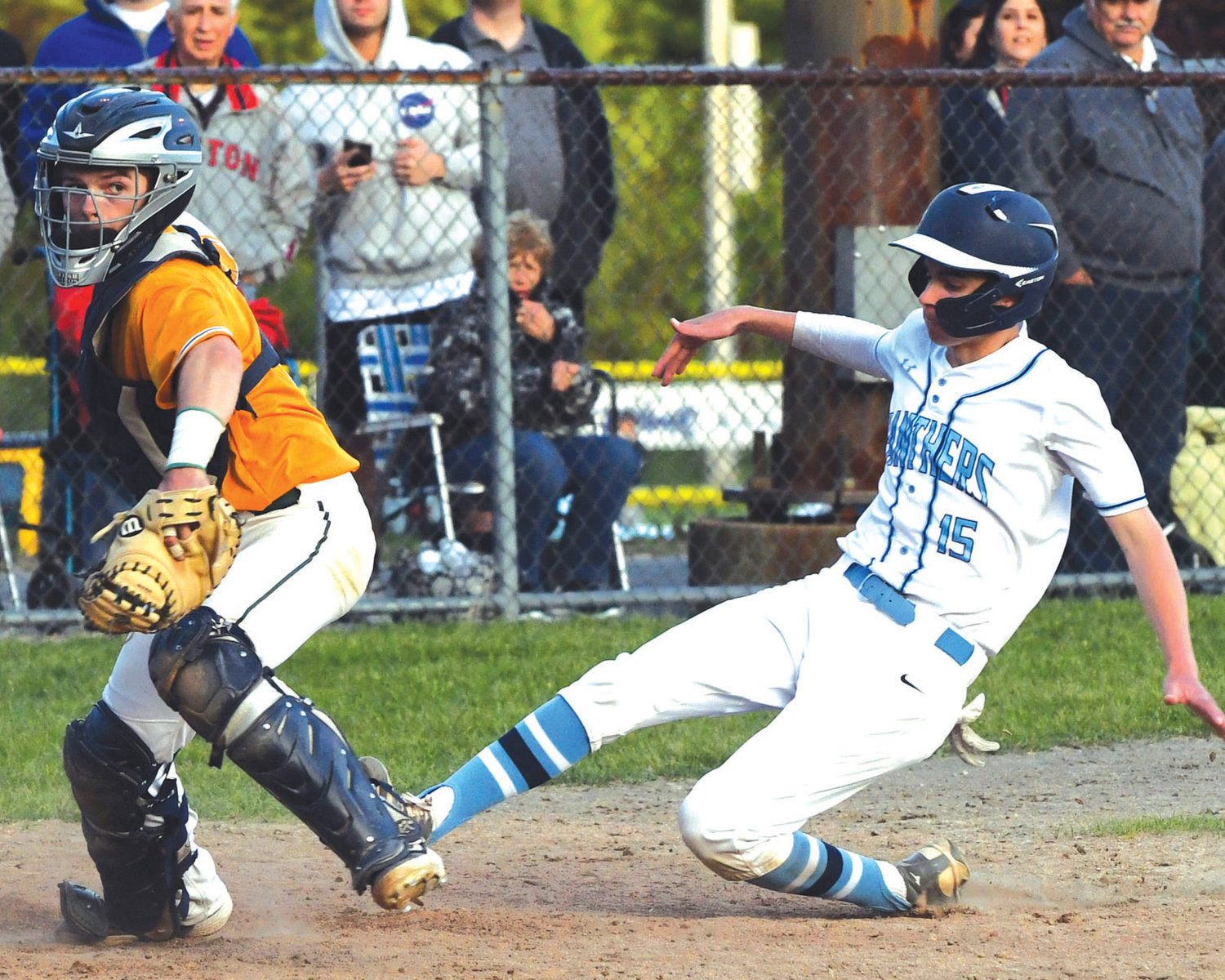HEADED FOR HOME: Johnston's David Iannuccilli slides into home.