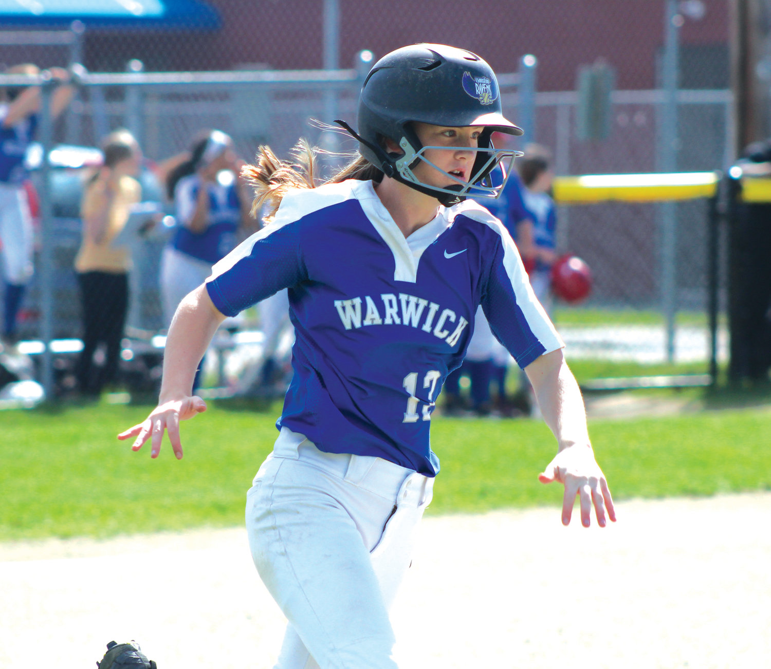 THE PERFECT SEASON: Warwick Vets' Gillian Brown rounds first base after picking up a hit against Park View during the team's regular season finale at Vets.