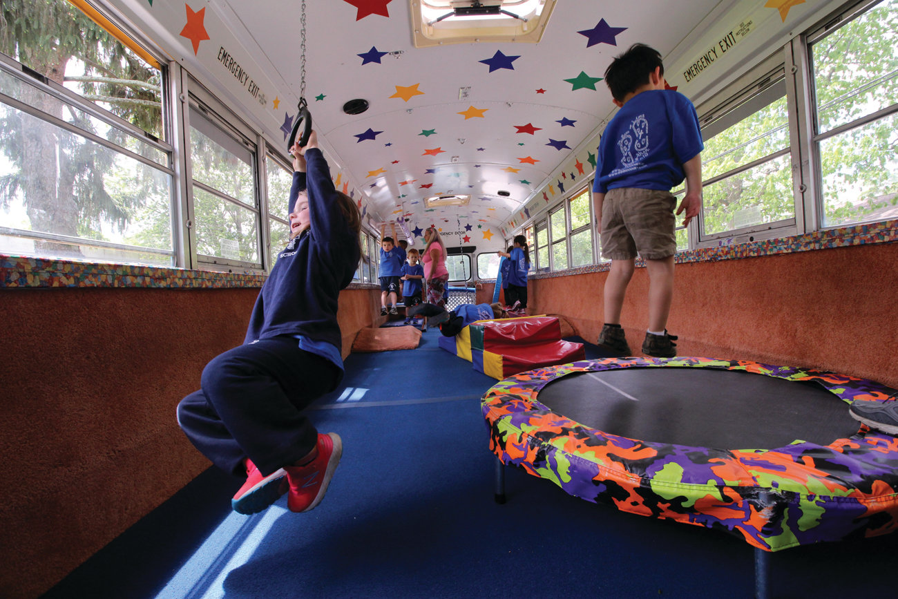 NOT ALLOWED ON MOST BUSES: Imagine being encouraged to jump around, swing from monkey bars and bounce on a trampoline while in a school bus. That's just what the Tumblebus offers for preschoolers and parties and it was a hit with the kids at St. Rose.