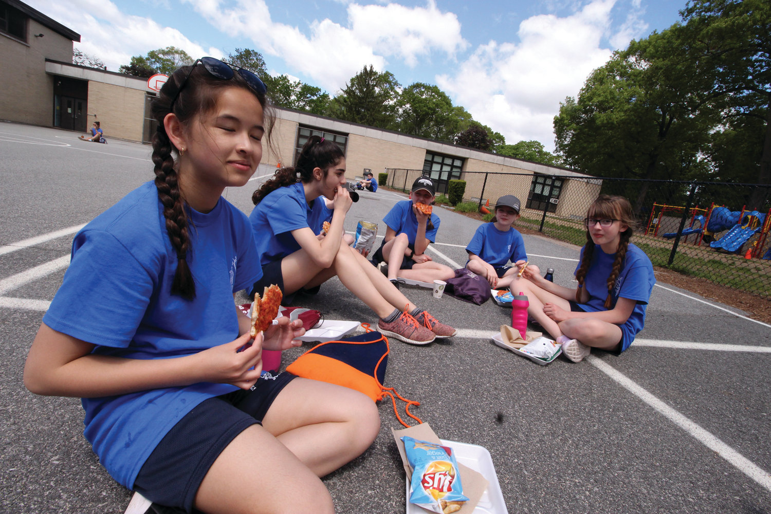 PICNIC CONDITIONS: Fifth and sixth graders gather to enjoy a pizza lunch after completing their walk estimated to be five miles.