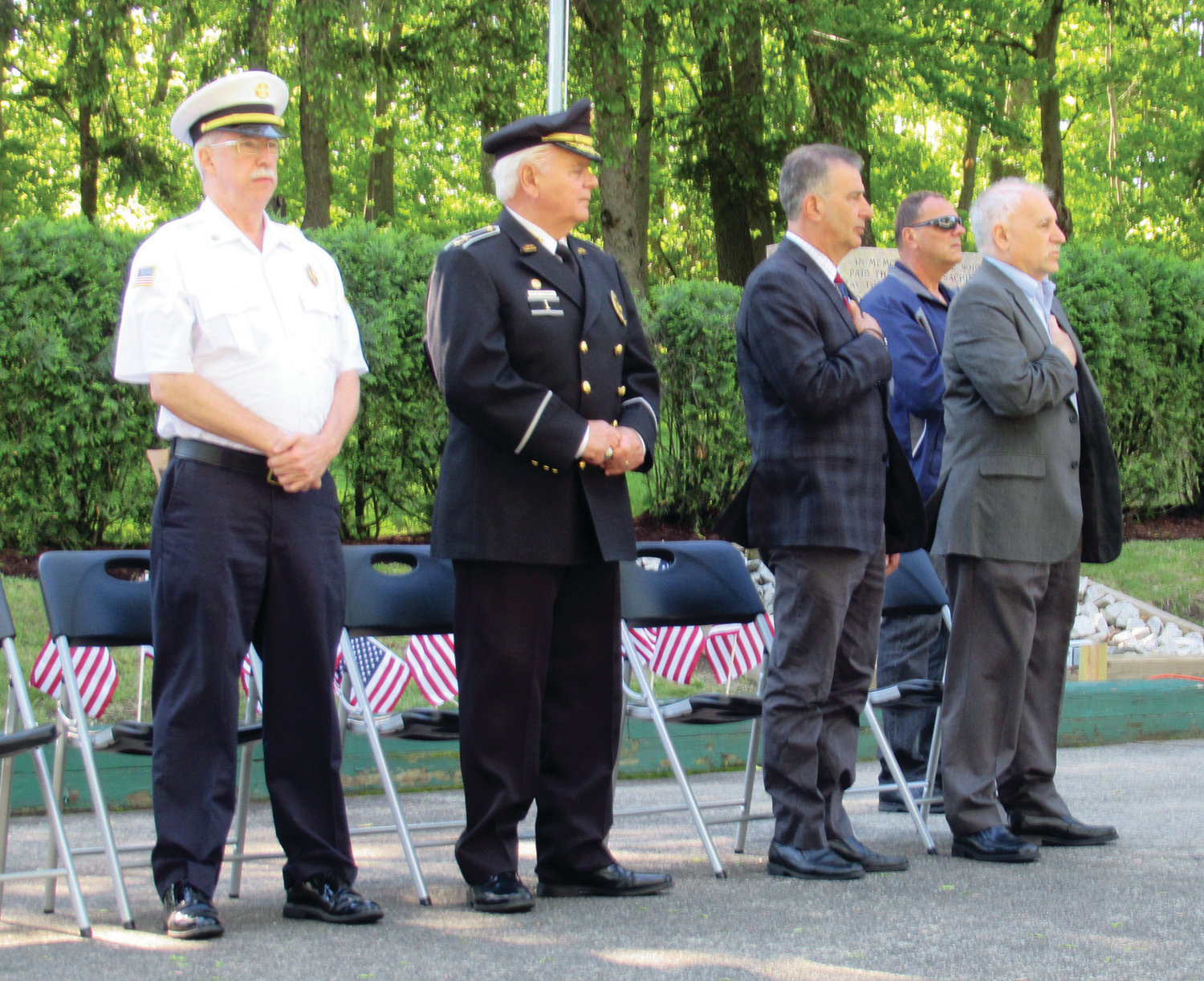SUPER SALUTE: Johnston officials like Fire Chief Peter Lamb, Police Chief Richard S. Tamburini, state Sen. Frank Lombardo and Parks and Recreation Director Dan Mazzulla, who emceed the impressive ceremony, helped the town honor its heroes.