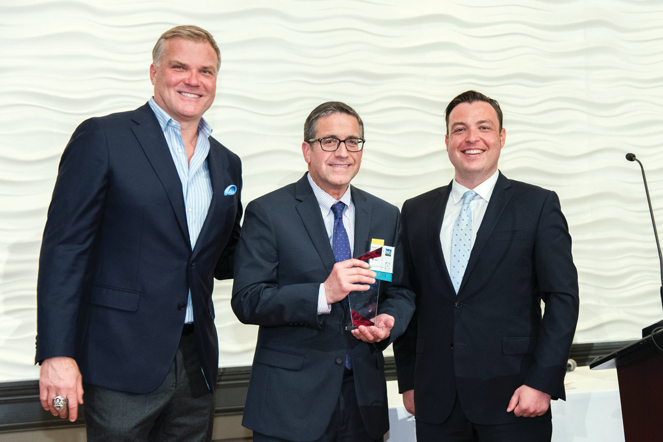 MAN OF THE HOUR: Jay Elias of Warwick is flanked by Scott Zolak, former Patriots quarterback and sportscaster (left) and Brian Doherty, president and CEO of Mass-ALA, at the ceremony where Elias received his volunteer award.