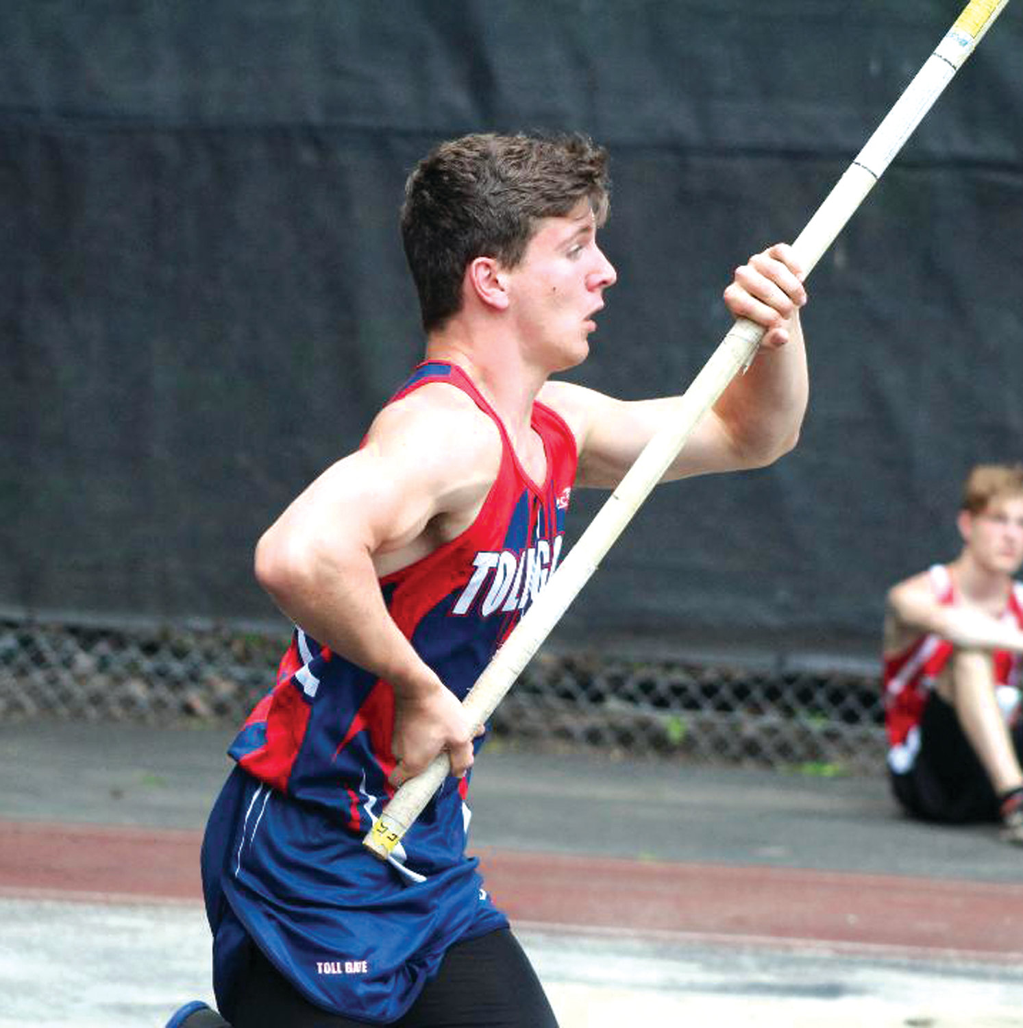 TAKING BRONZE: Toll Gate's Justin Perreault competes in pole vault.
