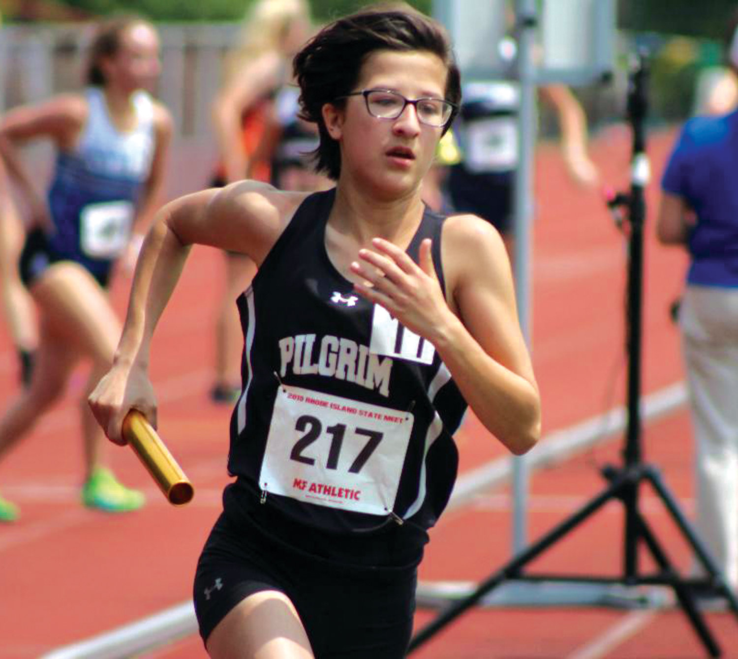 HITTING THE TRACK: Pilgrim's Ava McCann competes in a relay race.