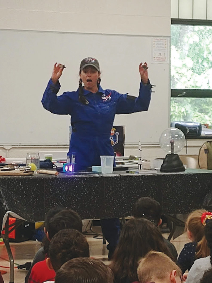 SOUVENIRS FROM SPACE: During her presentation, NASA Solar System Ambassador Renee Gamba showed the students a variety of items, including models of the solar system and small space rocks that could damage an astronaut's pressurized space suit.