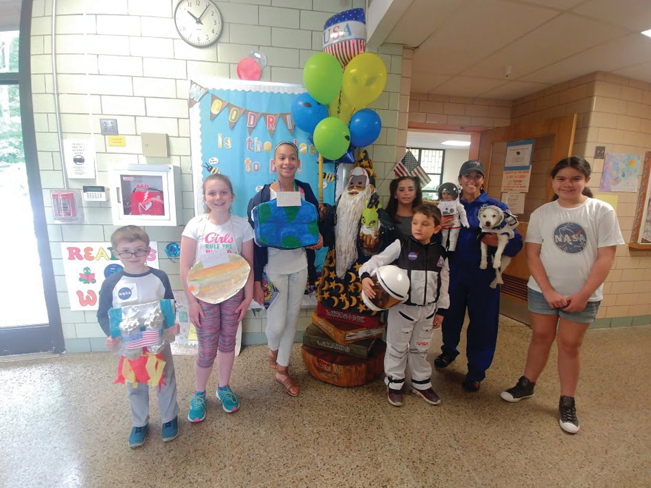 A FEW SPACE FANS: Woodridge students Katelyn Snedeker, Natalia Jackson, Tyler Parente, Lilliana Prendergast, Giana Giordano and Russell Pine showed off their enthusiasm for the space theme with Gamba and Astro-Dash.