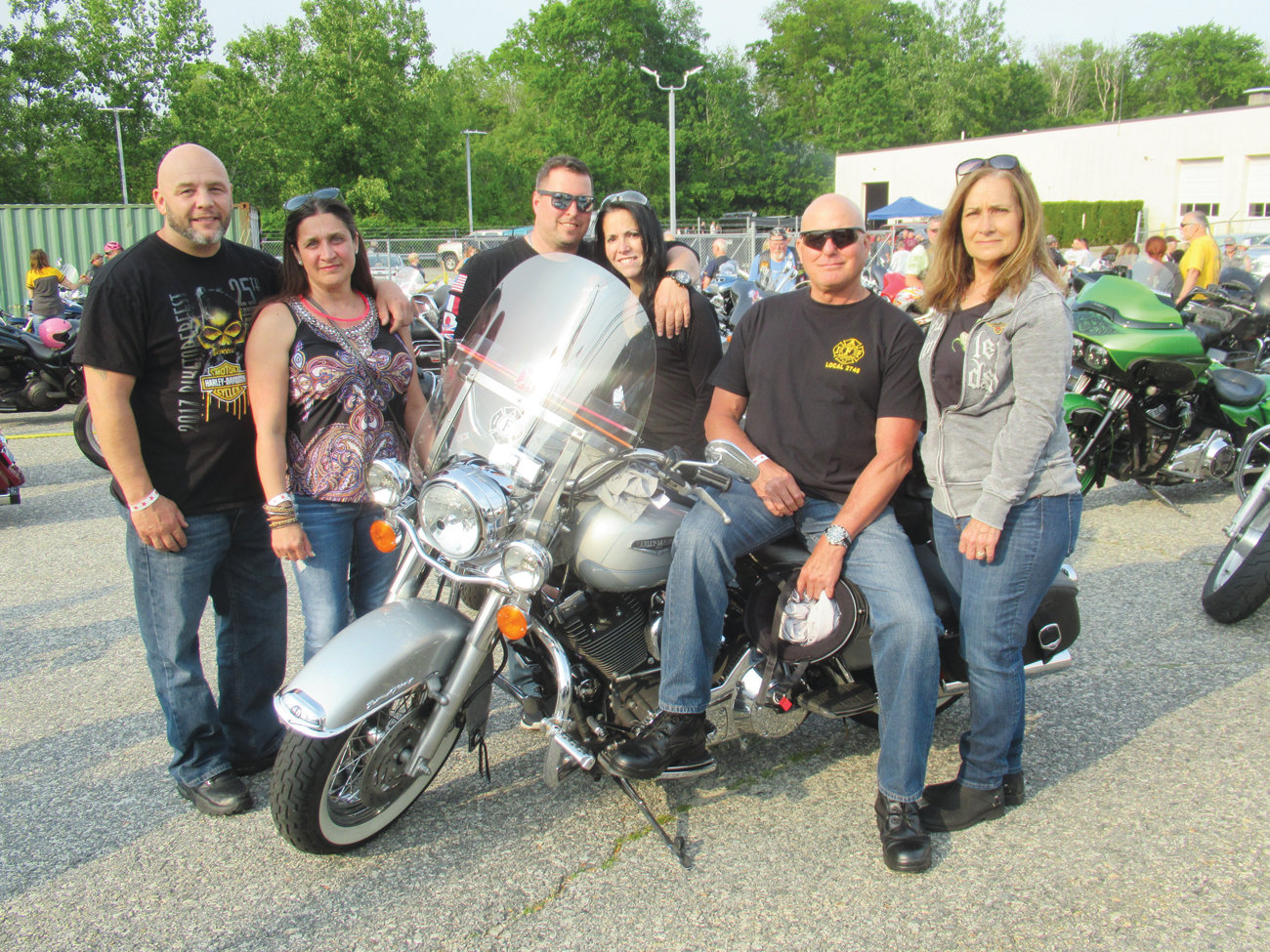 SPECIAL SUPPORTERS: Retired Warwick firefighters Mike Clarke (fifth left) and his friends Paula Larson, Robert Mirabella, Dave Farman, Nancy Roy and Laura Brasil were part of the record-setting 1,000 plus motorcyclists that raised upwards of $30,000 Saturday.