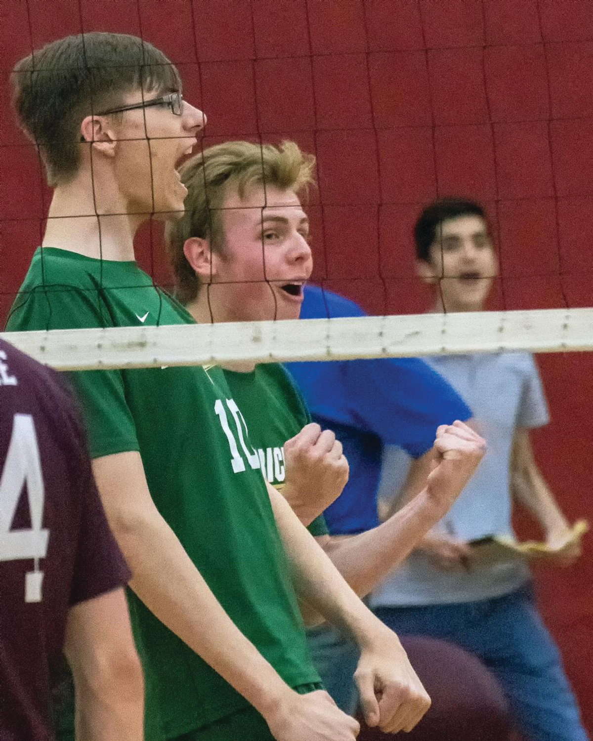 AT THE NET: Bishop Hendricken's Zachary Fraser and Nathan Bowe celebrate against La Salle.