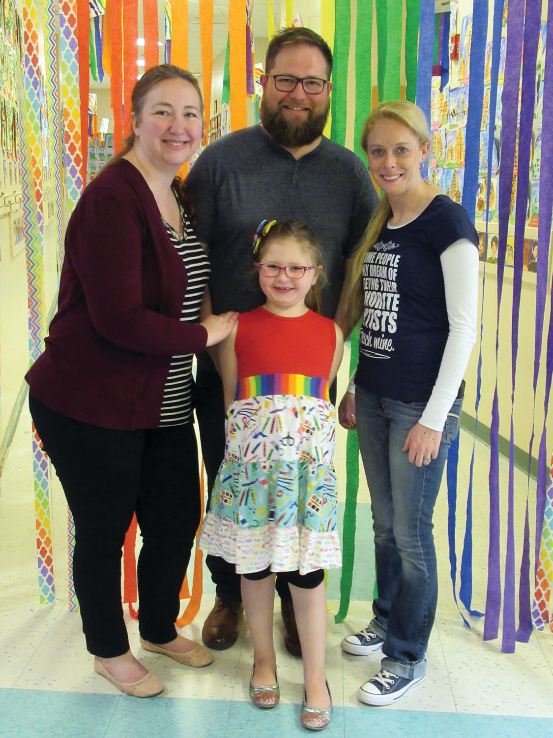 KIM'S KORNER: ECC art teacher Kim Marshall, right, receives congratulations from her family – Harry, Jane and Ryleigh Cole – who took in Friday night's ECC Art Show.