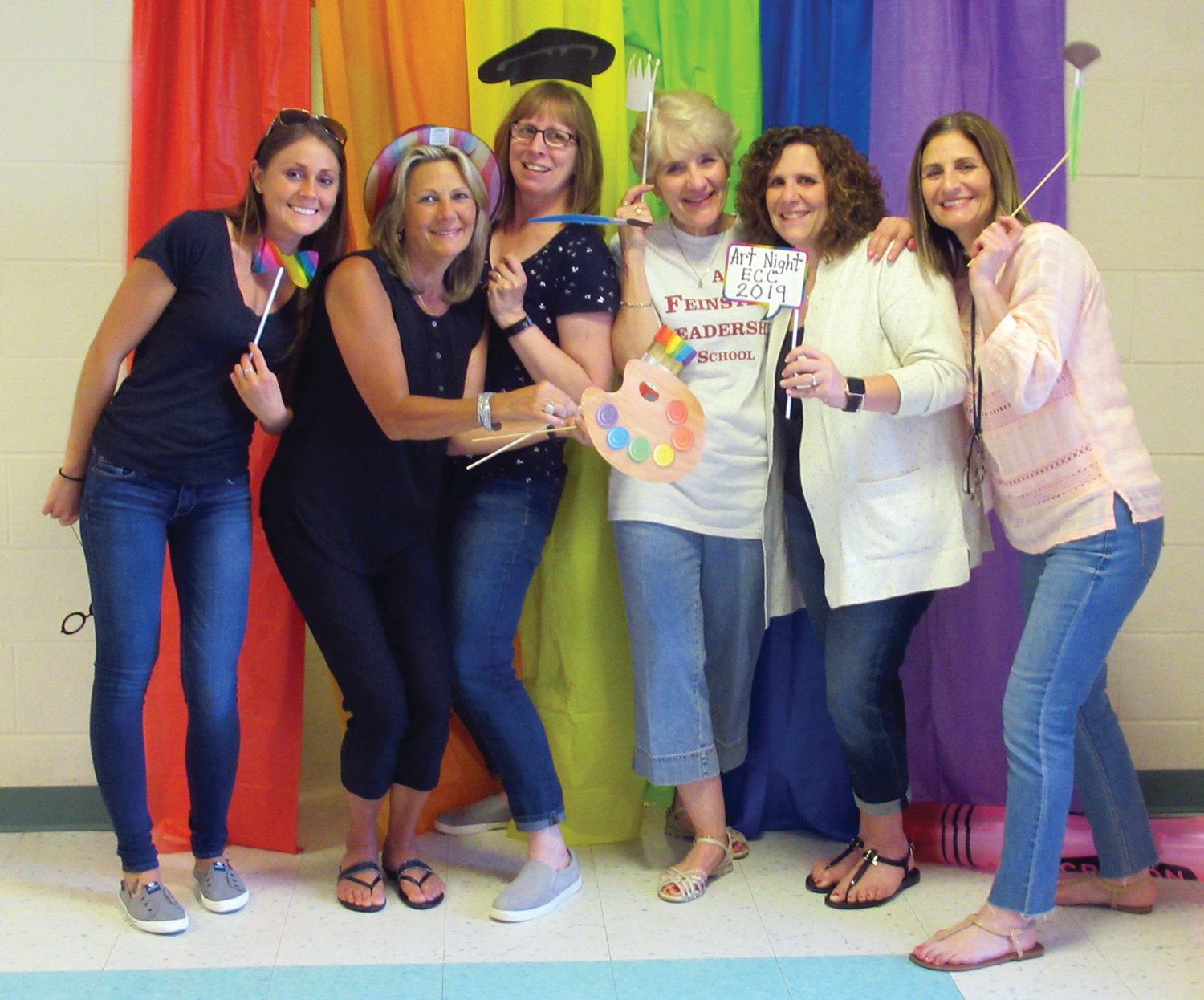 TEACHER'S TAKE: ECC teachers Lauren Cardillo, Pat Cardillo, Cathy Alber, Bonnie Duhamel, Toni Lynch and Lori Auteillo ham it up during their visit to the ECC's photo booth, which was a huge hit during Friday night's art show.