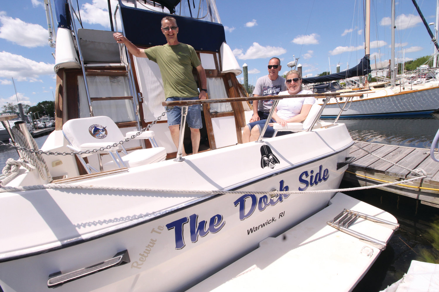 SET TO SAIL WITHOUT SAILS: Tim Palmer, who loves sailing and for years has owned a sailboat, now owns a powerboat. He was joined by his sister and brother in-law, Robin and Glen Rich, for a Memorial Day cruise on Greenwich Bay.