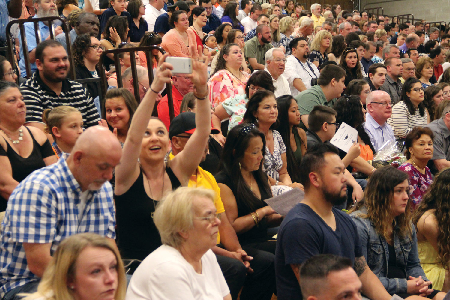 SHOT FROM THE CROWD: The bleachers were filled as friends and family packed the CCRI field house for the Pilgrim commencement.