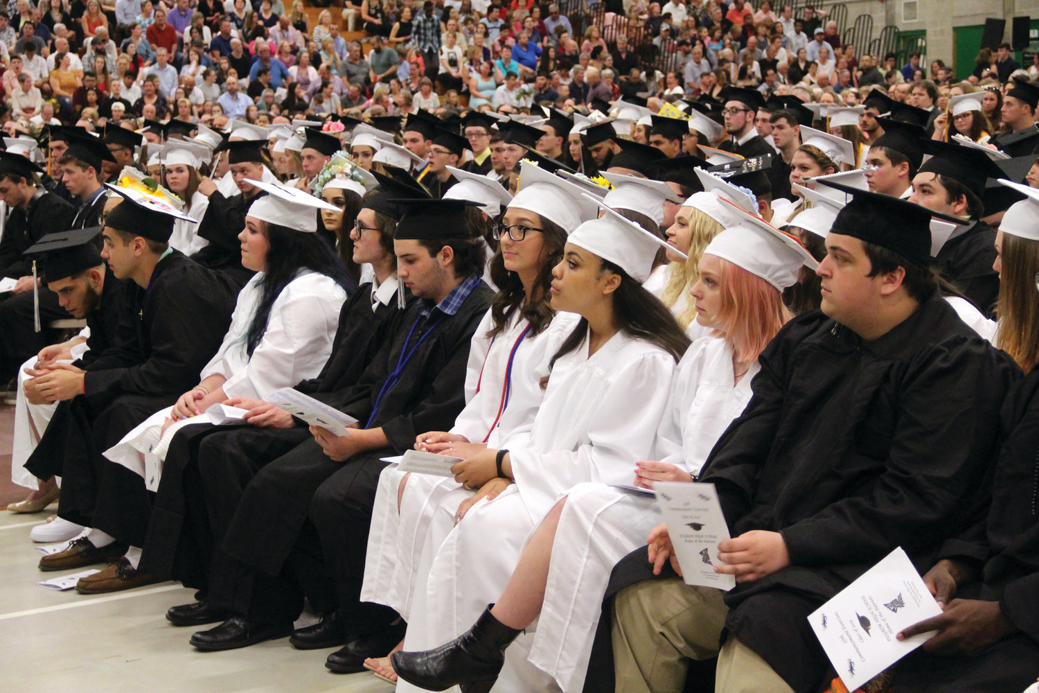 CLASS OF 2019: Pilgrim seniors wait for the start of commencement exercises last Wednesday at CCRI.