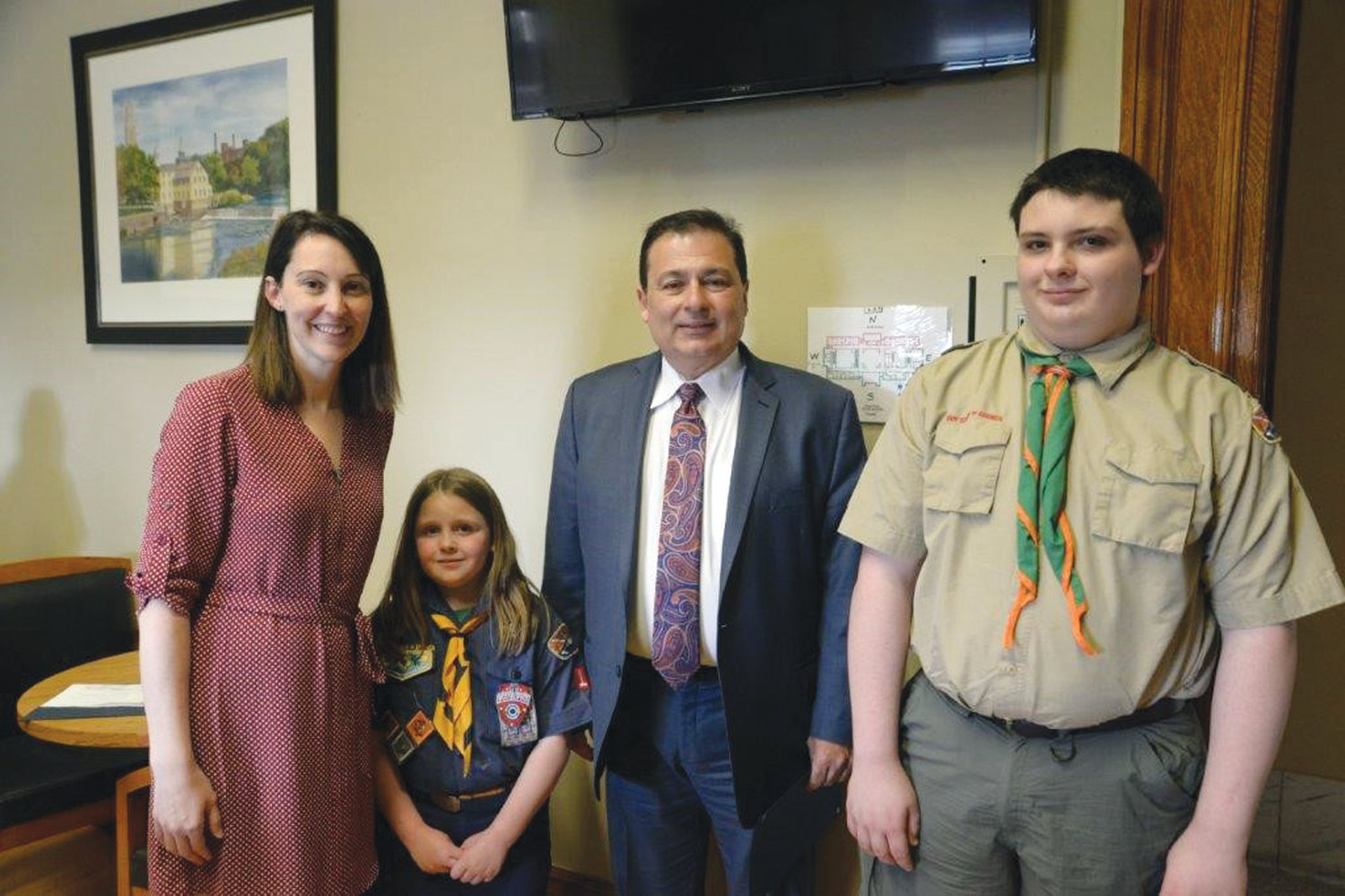 LEADING THE PACK: Tiffany Bumgardner-Scheffler, Director of Field Services/COO of the Narragansett Council; Justina Ladino; Majority Leader Shekarchi and James Ladino pose during the recent Narragansett Council, Boy Scouts of America (NCBSA) tour of the State House.