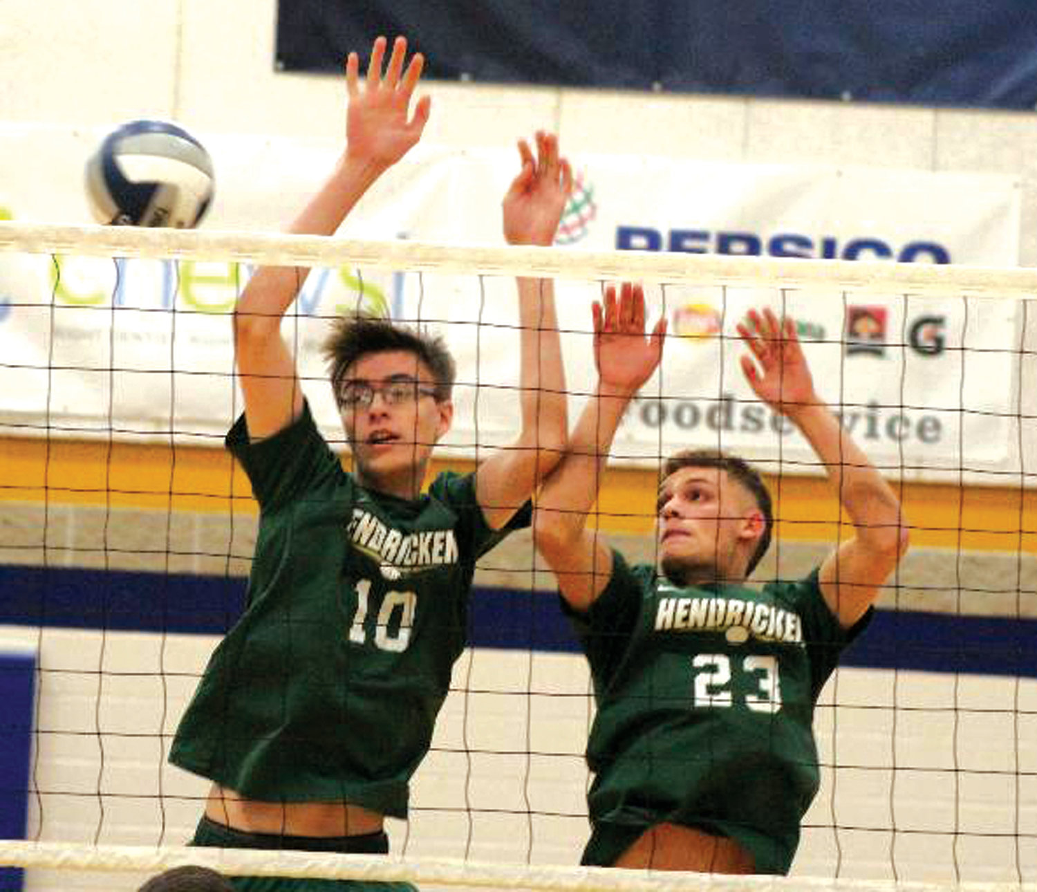 AT THE NET: Bishop Hendricken's Zachary Fraser and Jose Lamendola go up for a block against Coventry.