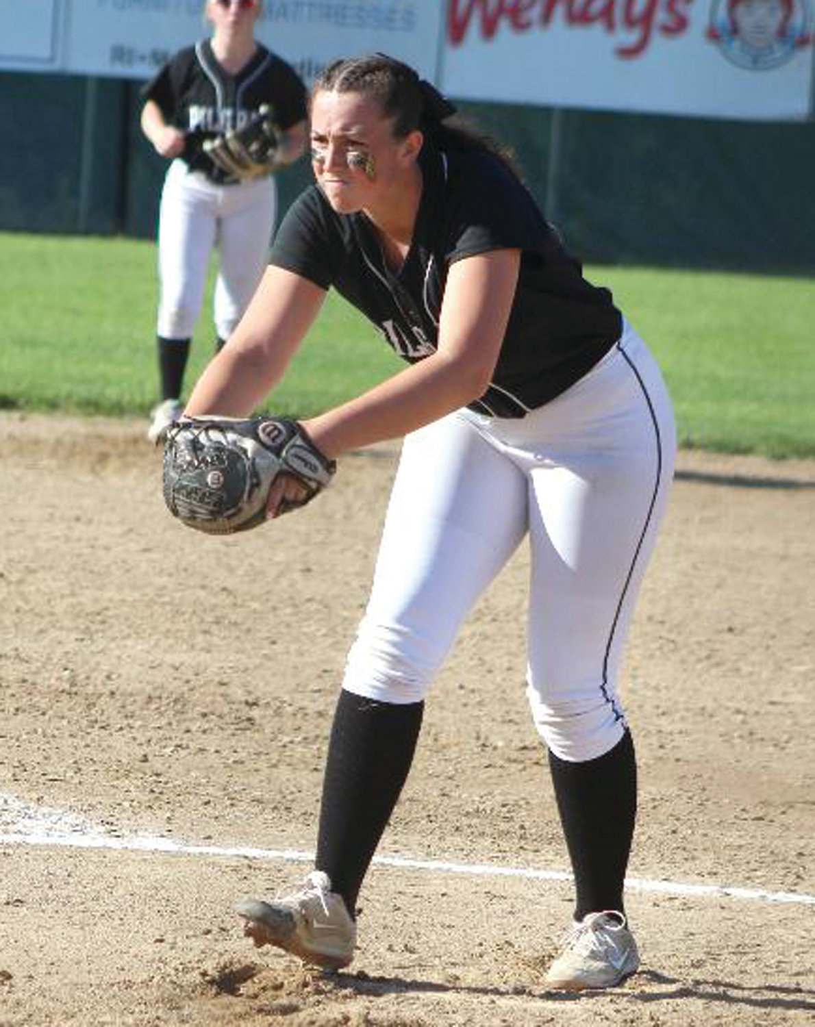 IN THE CIRCLE: Pilgrim pitcher Cat Fallon winds up to pitch against Coventry.