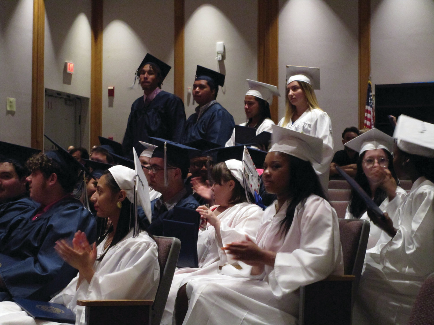 REASON TO CHEER: NEL/CPS Construction & Career Academy graduates cheer on their fellow classmates during the ceremony.