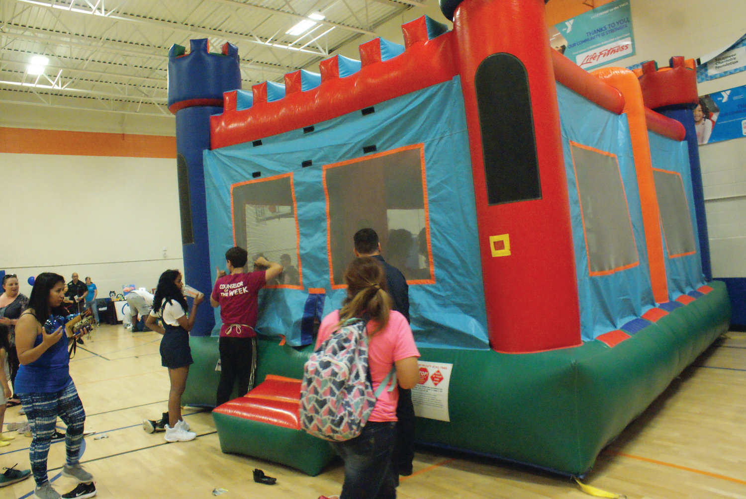 BOUNCE TIME: On of the more popular activities at the Out of School Time Carnival held at the Cranston YMCA on June 6 was the bounce house.