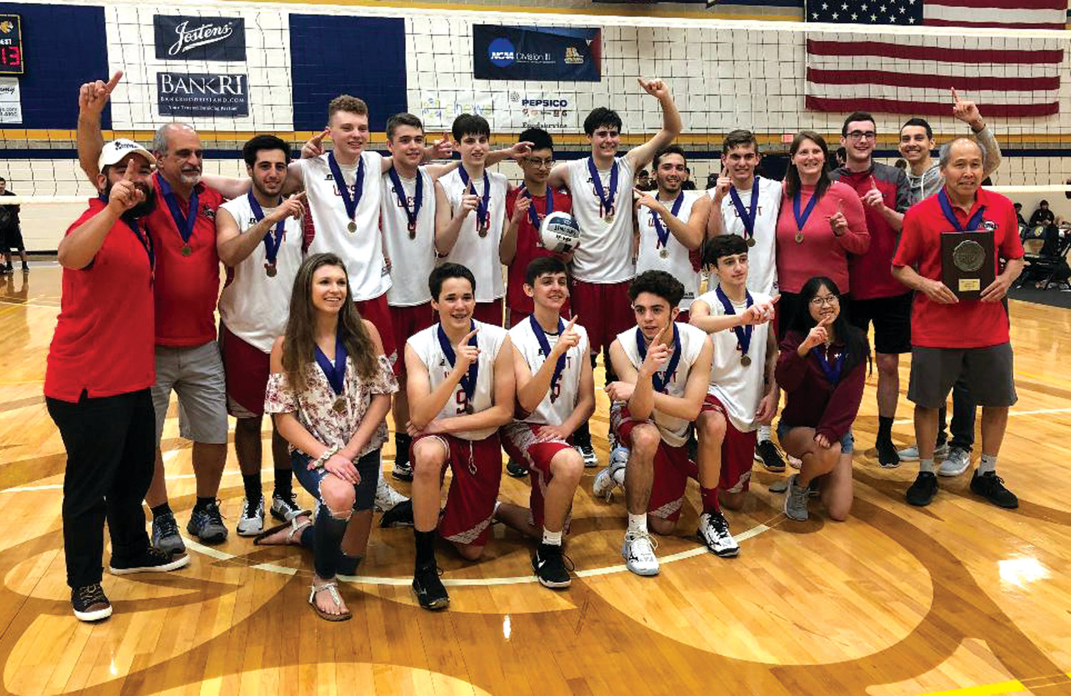 STATE CHAMPS: The 2019 Cranston West boys volleyball team celebrates after winning the Division II State Championship over reigning champion East Greenwich on Monday night at Johnson and Wales University in Providence. The Falcons won 3-0, by scores of 25-15, 25-19, 25-13 for their first state title since the 2016 season.