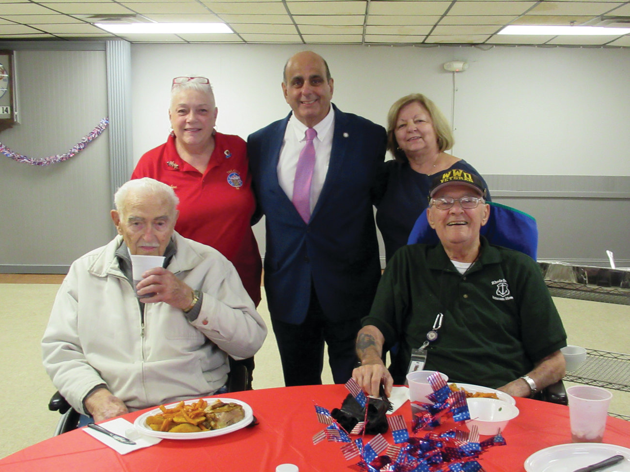 WARM WELCOME: Warwick Mayor Joseph Solomon, along with Elks volunteers Ann Licciardi and Cynthia Holmes welcome U.S. Air Force veterans Rudy Viens and U.S. Navy veteran John D'Angelo to last Thursday's D-Day Luncheon.