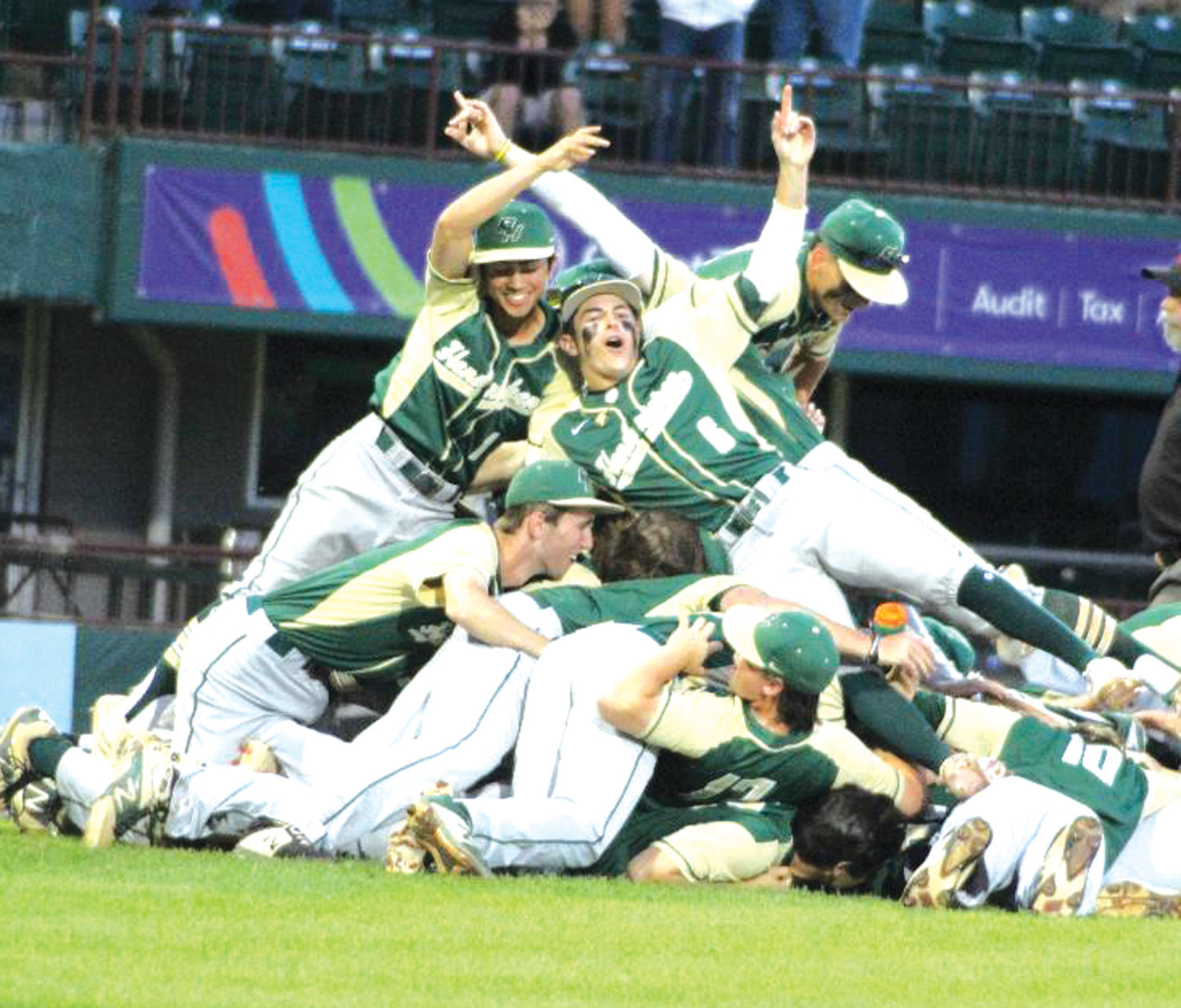 CELEBRATE GOOD TIMES: The Bishop Hendricken baseball team celebrates on the field at McCoy Stadium after getting the final out to clinch the 2019 D1 baseball title over La Salle.