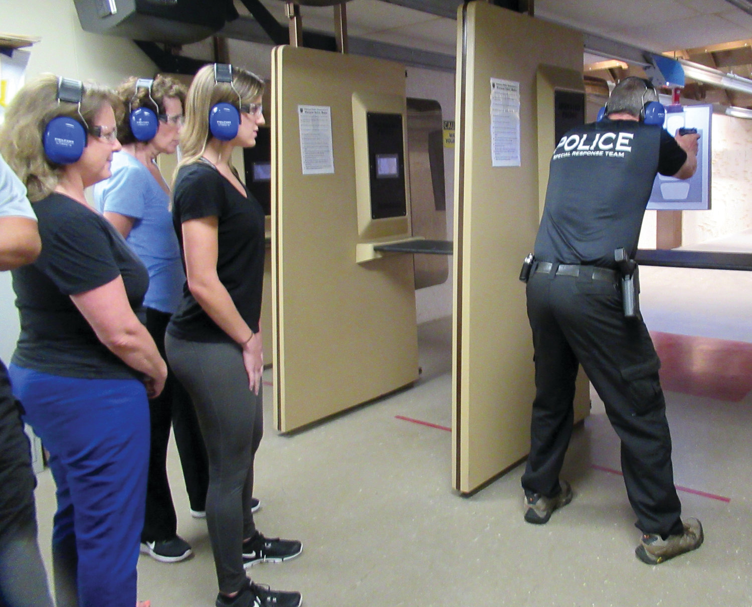 PERFECT POSITON: Det. Jim Seymour, the Johnston Police Department's shooting expert, demonstrates the proper position to participants in the Citizens Police Academy prior to last week's shooting practice in the downstairs range.