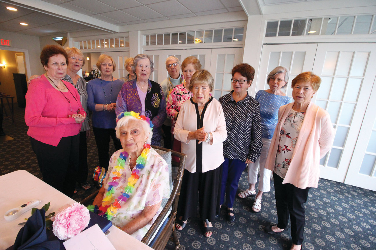 BELLE OF THE PARTY: Eunice Pratt is surrounded by alumni of the Friends of the Warwick Public Library at their annual meeting Thursday at the Warwick Country Club. At 100, Eunice is the elder member of the group.