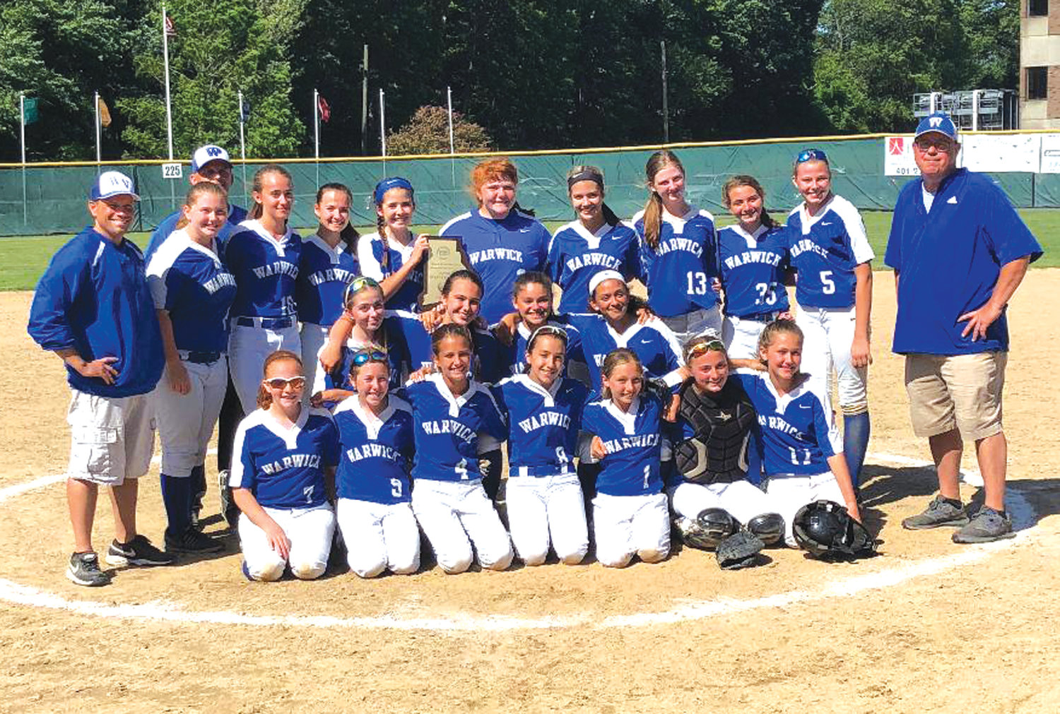 WE ARE THE CHAMPIONS: The 2019 state champion Warwick Vets Middle School softball team after winning the title at Rhode Island College.