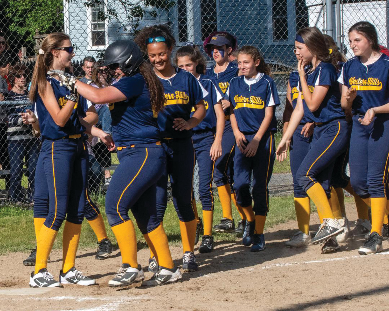 WELCOME HOME: Western Hills celebrates after a home run.