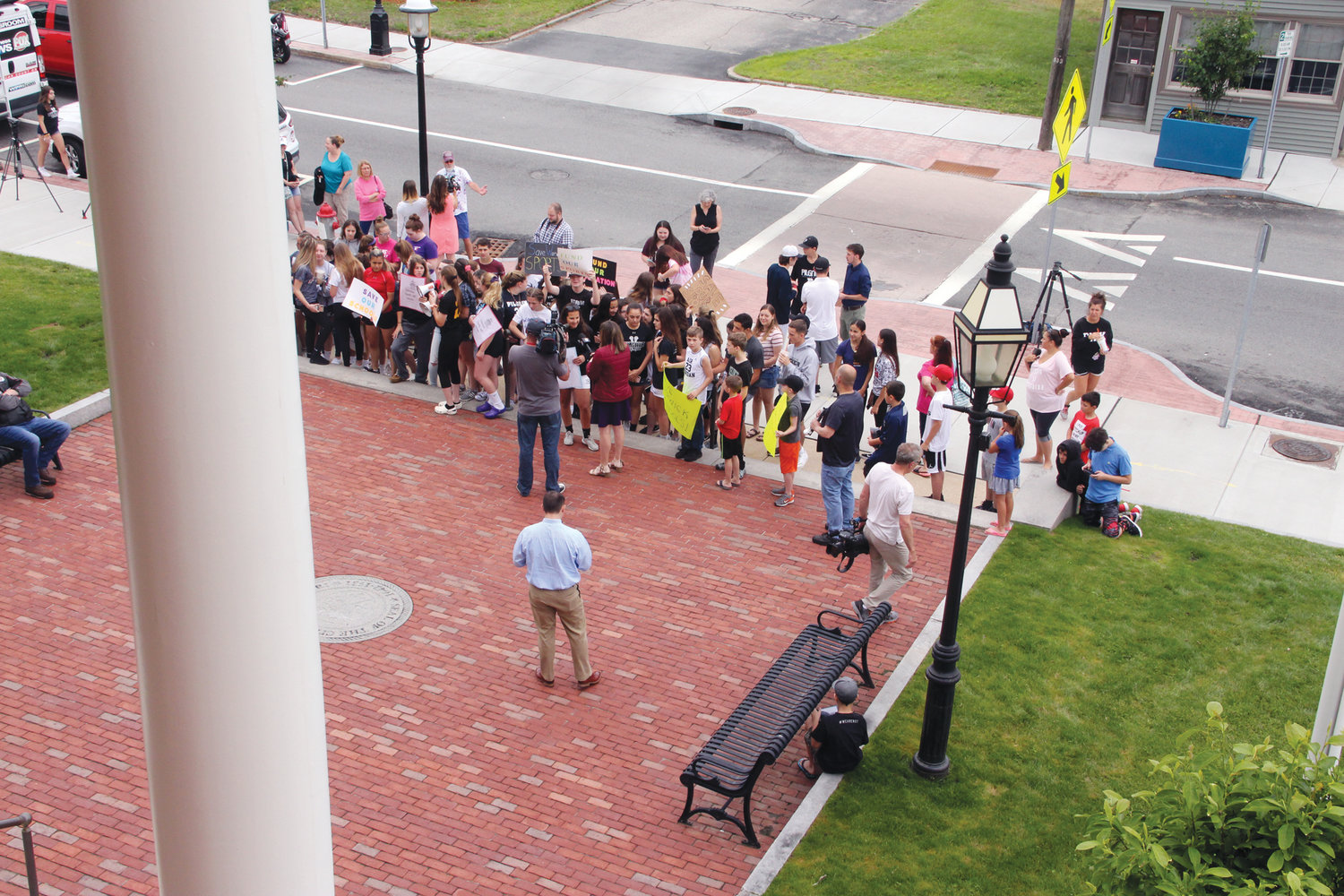 LETTING IT BE HEARD: Members of the Warwick sports community gather outside of Warwick City Hall on Wednesday morning.