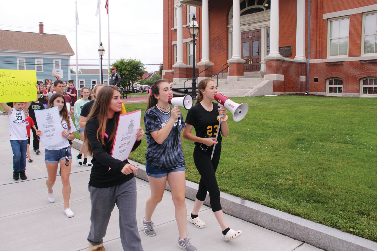 MARCHING ON CITY HALL: Pilgrim girls soccer players Janelle Mixner, Lindsay Flanders and Amelia Murphy led fellow student athletes in Wednesday's demonstration outside City Hall. As the group grew they entered the lobby of City Hall, only leaving after a delegation met with the mayor.