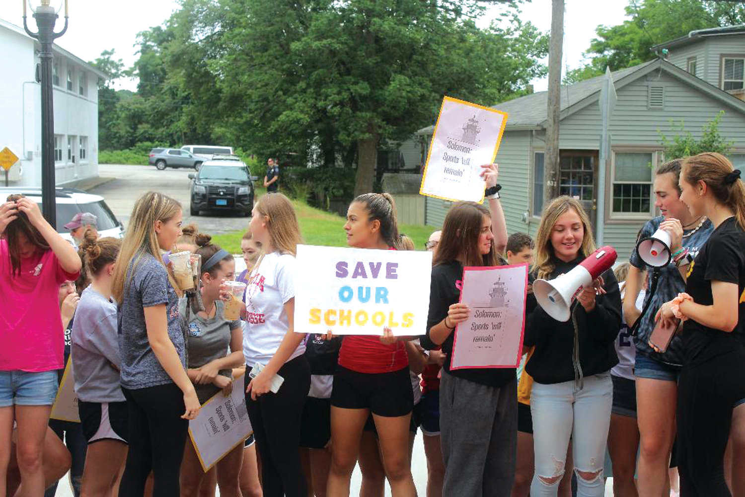 LOUD AND CLEAR: Members of the Warwick sports community gather outside of Warwick City Hall on Wednesday morning to protest the recently-approved budget cuts proposed by the Warwick School Committee, which included after school clubs and sports.