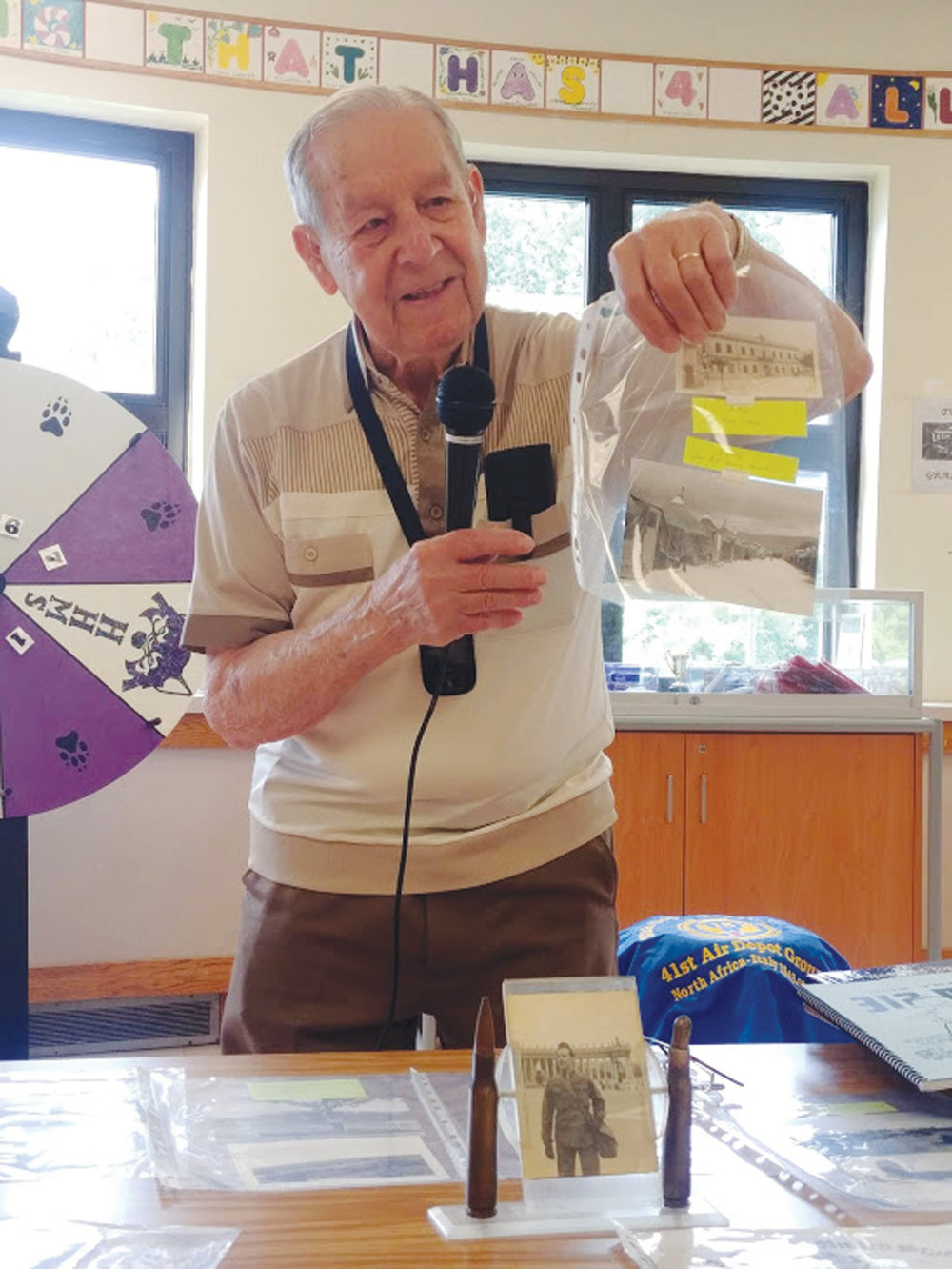 MEMORIES OF THE WAR: Domenic Giarrusso had a great deal of World War II memorabilia on display during his visit to Hope Highlands, including photographs, dog tags, ammunition, books and news articles.
