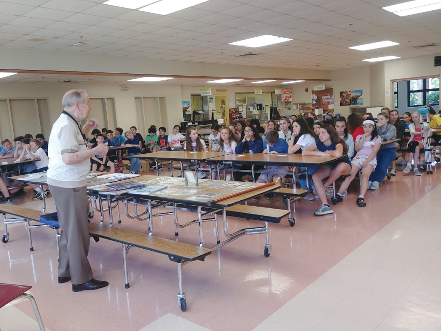 LESSONS FOR LIFE: The students at Hope Highlands Middle School listened to Domenic Giarrusso as he spoke of his time serving in World War II.