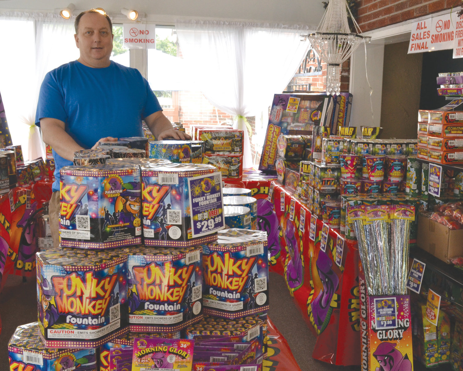 John Dick stands among a few of the many fireworks he offers at Atwood Florist.