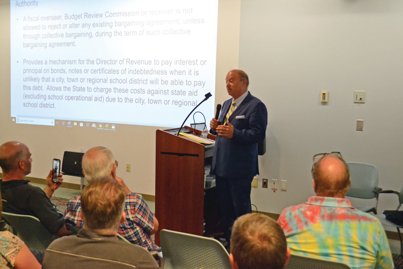 TOPICAL EXPERT: Former Rhode Island Supreme Court judge and U.S. Senate candidate Bob Flanders speaks with attendees of the Warwick Financial Crisis Committee on Thursday night at Warwick Public Library.