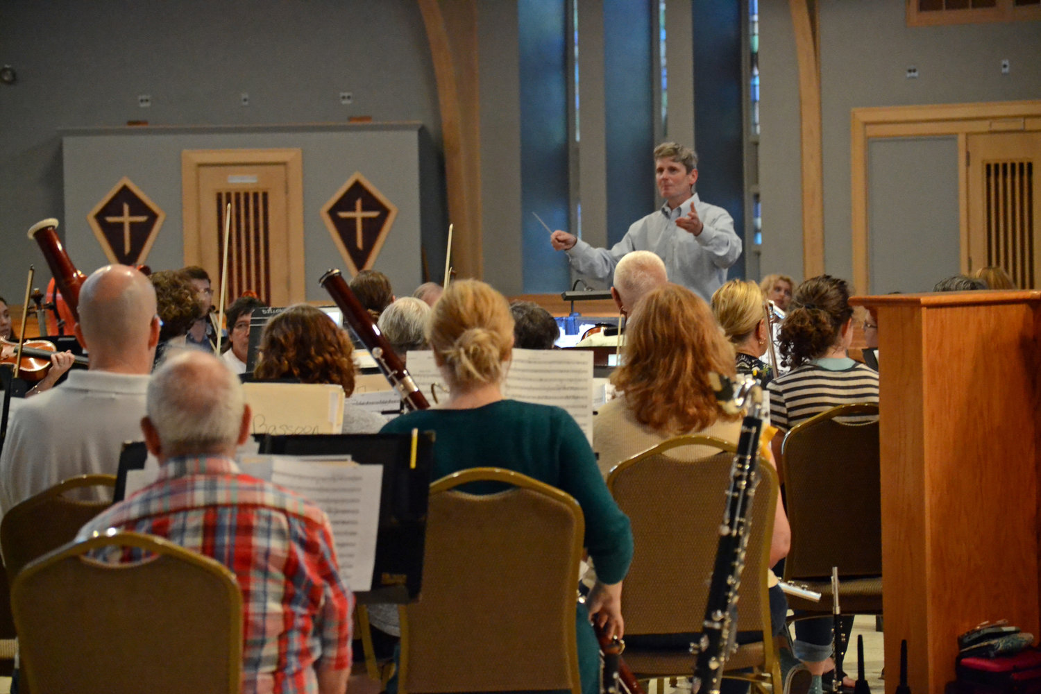 GOOD CONDUCT: Music Director Dr. Brian Cardany, in his inaugural season with the Pops, lifts the orchestra into a swell during a rehearsal at St. Kevin on Tuesday night.