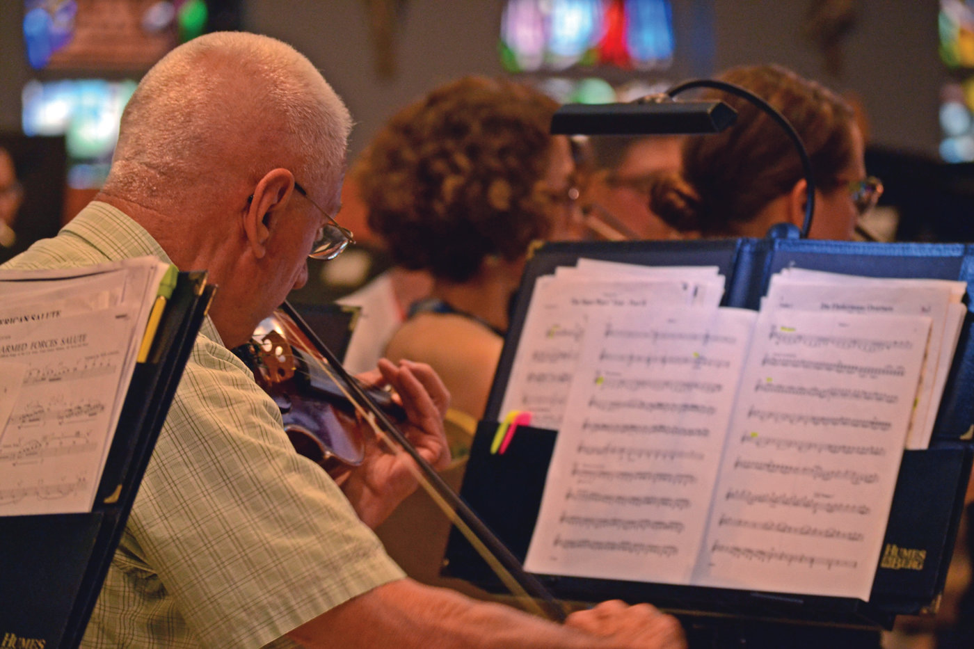MIND THE NOTES: Violinist Jerry Lupien paid keen attention to his sheet music while practicing with the Ocean State Pops.