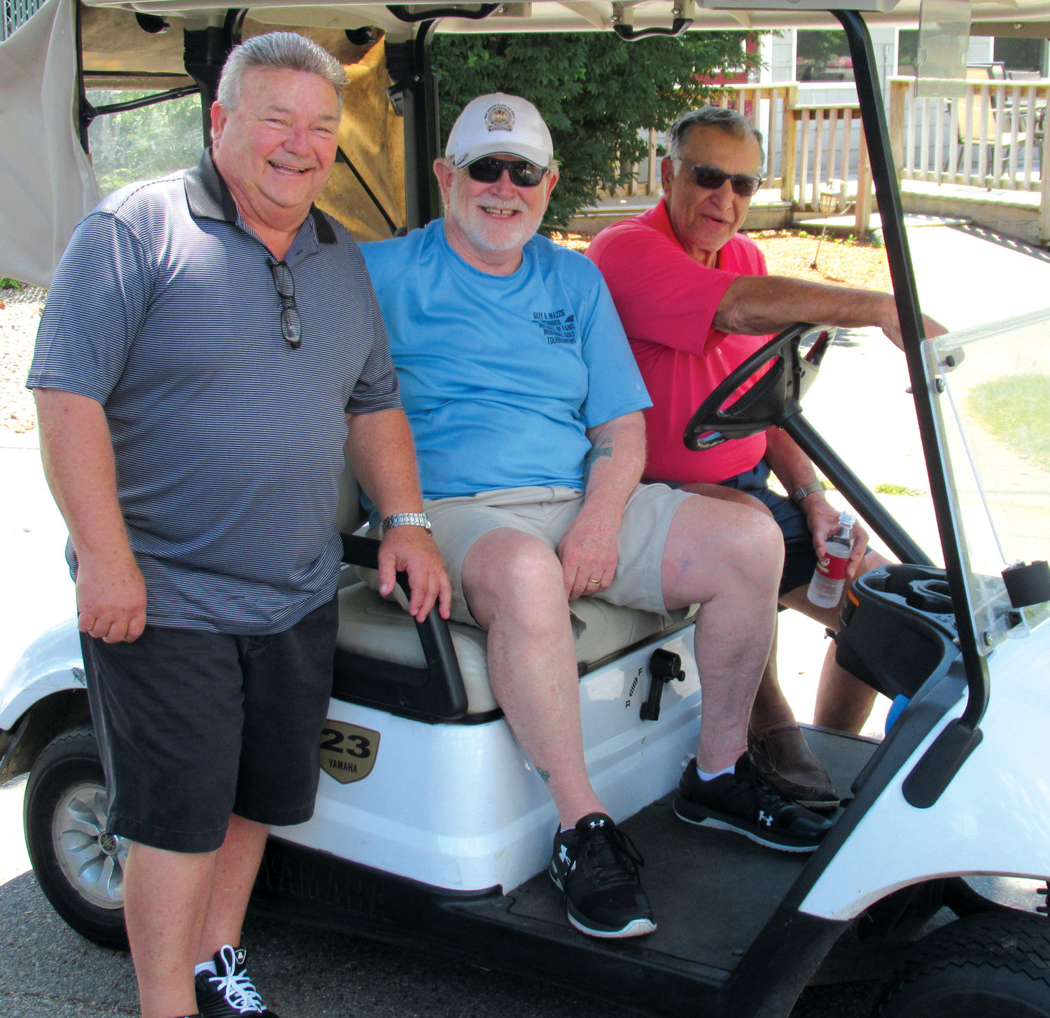 FAMED FACES: Ed Skovron, Chairman Jim Hopkins and Dennis Quaranta enjoy a lighter moment prior to Monday's tee off of the annual Johnston High School Athletic Hall of Fame Golf Tournament.