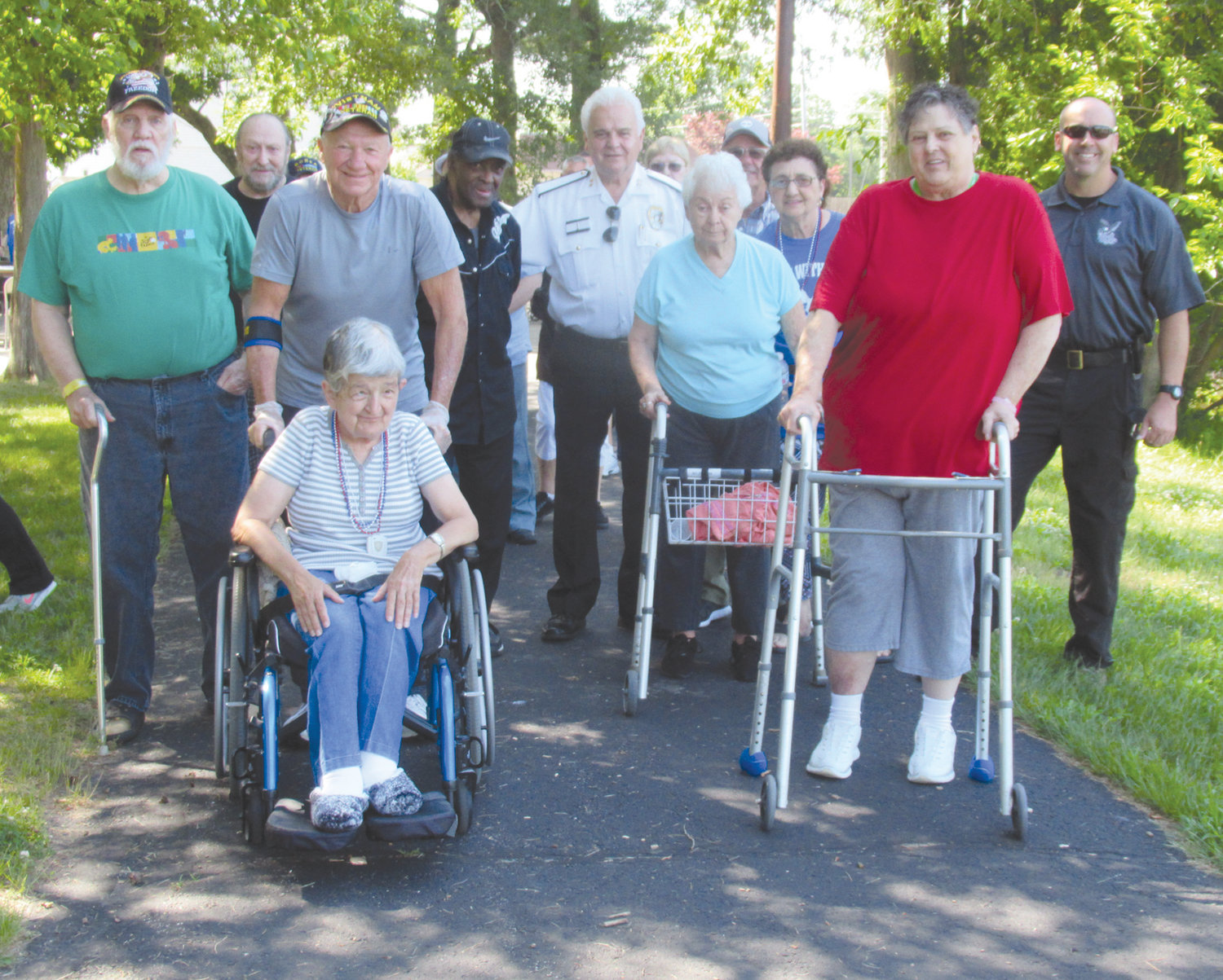 PARK PATROL: Jane Cimaglia had the honor of leading last Thursday morning's Walk with Cops season opener. She is assisted by veteran volunteer John Teolis as the traditional trek about Johnston War Memorial Park begins.
