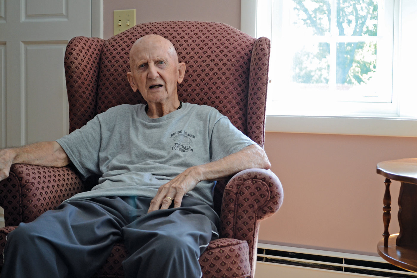 GOING STRONG: D-Day and Iwo Jima veteran Ray Raiche sits in his Governor Francis home on Monday. At 93 years old, he will be the youngest Iwo Jima survivor to participate in the Bristol 4th of July Parade.