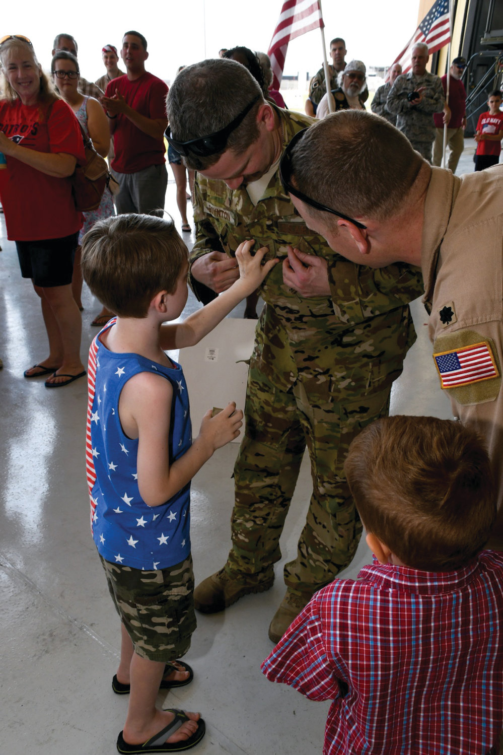 MOVING UP: Technical Sgt. Andrew M. Boynton from the 143d Airlift Wing of the Rhode Island Air National Guard was promoted to the rank of master sergeant during his return from deployment on July 5.