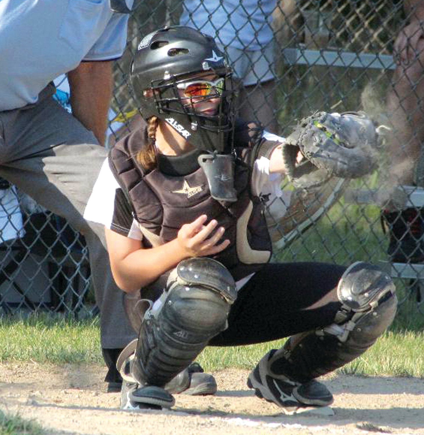 DOING BATTLE: Warwick North catcher Genna D'Amato works behind the plate against East Greenwich in the District 3 Championship last week at Bend Street.