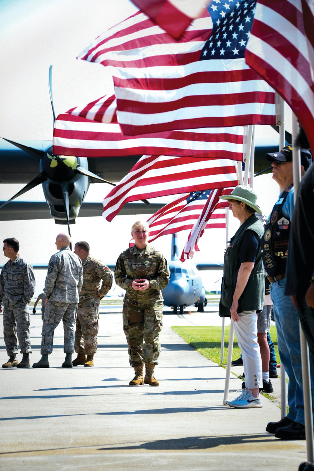REASON TO SMILE: Brig. Gen. Kimberly A. Baumann, assistant adjutant general of the Rhode Island Air National Guard, welcomes home more than 100 Airmen from the 143d Airlift Wing on July 5 at Quonset.