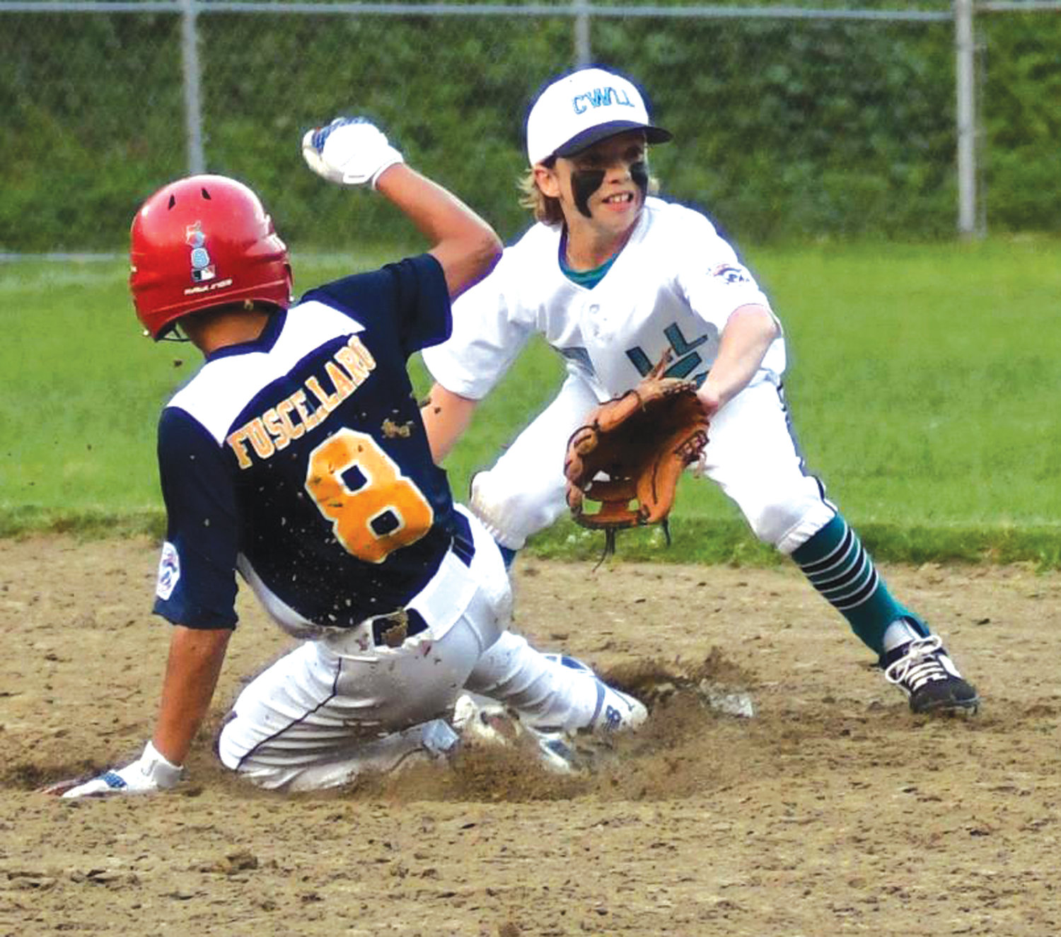 SLIDING IN: Cranston Western's Ethan Madden gets ready to apply the tag on a North Providence runner trying to steal second base.